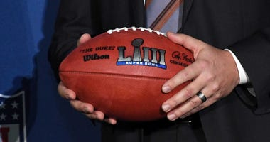 Atlanta Sports Council president Dan Corso holds a Super Bowl LIII logo football