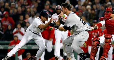 New York Yankees first baseman Tyler Austin (26) starts a scrum with Boston Red Sox relief pitcher Joe Kelly.