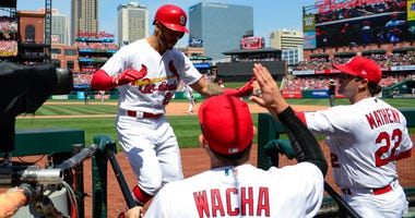 St. Louis Cardinals center fielder Tommy Pham (28) is congratulated by starting pitcher Michael Wacha (52) and manager Mike Matheny