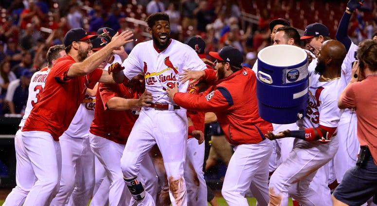 St. Louis Cardinals right fielder Dexter Fowler (25) celebrates with teammates after hitting a walk off two run home run