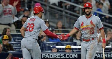 Matt Carpenter congratulates his St. Louis Cardinals teammate Tommy Pham.