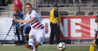 United States forward Josh Sargent (13) scores a goal past Bolivia
