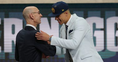Michael Porter, Jr. (Missouri) greets NBA commissioner Adam Silver after being selected as the number fourteen overall pick to the Denver Nuggets