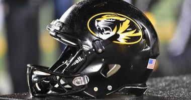 Missouri football helmet sits on the bench
