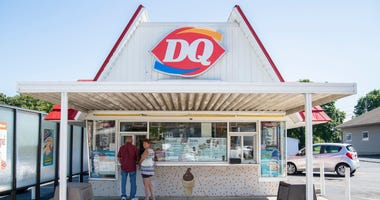 A man and woman wait in line at the Dairy Queen on Richmond's north side, 837 10th St., on Friday, Sept. 14, 2018.