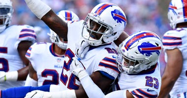 Buffalo Bills defensive back Vontae Davis (22) and defensive back Micah Hyde (23) celebrate
