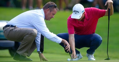 Aaron Wise gets a ruling from the official on the fifth hole during the second round of the Tour Championship