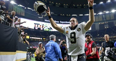 New Orleans Saints quarterback Drew Brees (9) runs off the field