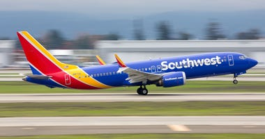 A Southwest Airlines Boeing 737 MAX 8 takes off from a cloudy San Jose International Airport in December 2018.