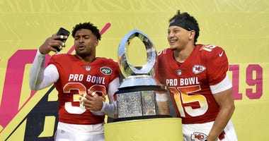AFC strong safety Jamal Adams of the New York Jets (left) poses with the trophy next to AFC quarterback Patrick Mahomes of the Kansas City Chiefs