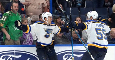 St. Louis Blues center Brayden Schenn (10) celebrates with defenseman Colton Parayko