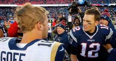 New England Patriots quarterback Tom Brady (12) is congratulated by Los Angeles Rams quarterback Jared Goff