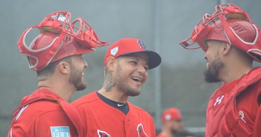 Catchers Yadier Molina, Andrew Knizner and Francisco Pena.