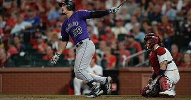 Nolan Arenado launches a ball into the seats against the Cardinals.