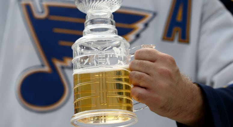 St. Louis Blues fan drinking beer at Stanley Cup Final watch party