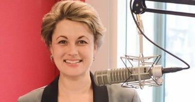 Debbie Monterrey behind the mic