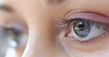 Closeup of staring eyes of young woman.