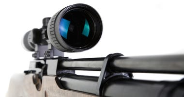 Close-up Shot of Precission Lens Scope on Snipers Rifle