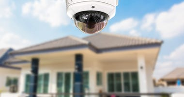 A house with a security camera outside.
