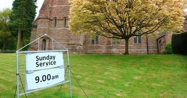 Chetwynd church with Sunday service sign in foreground