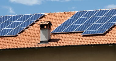 House roof with heat and power solar panels