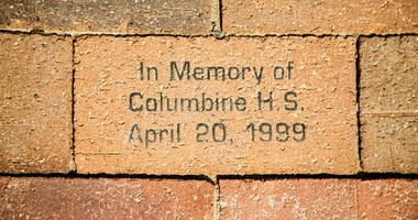 A bick in a sidewalk in Denver in memory of the Columbine High School shooting in April of 1999