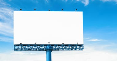 Big blank billboard with cloud and blue sky isolated on white background for new advertisement