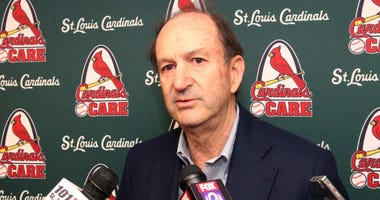 St. Louis Cardinals owner Bill DeWitt Jr., talks to reporters