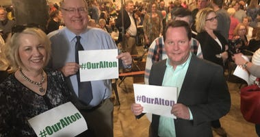 Supporters hold #OurAlton signs before the announcement was made.