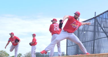 Pitchers throw a bullpen session at St. Louis Cardinals spring training