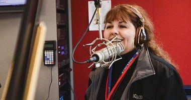 Maria Keena behind a mic