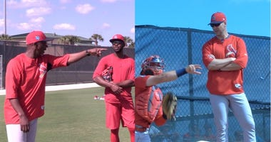St. Louis Cardinals coach Willie McGee and Chris Carpenter