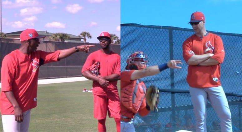 St. Louis Cardinals coach Willie McGee and Chris Carpenter