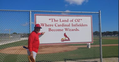 Hall of Famer Ozzie Smith stand by the Cardinals practice field in Jupiter, Fla. that has been named after him.