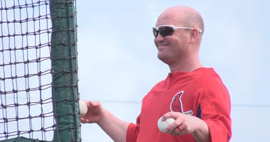 Memphis Redbirds manager Stubby Clapp throws batting practice.