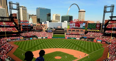 Fans look on as the Cincinnati Reds play the St. Louis Cardinals