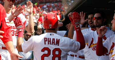 Tommy Pham high fives St. Louis Cardinals teammates