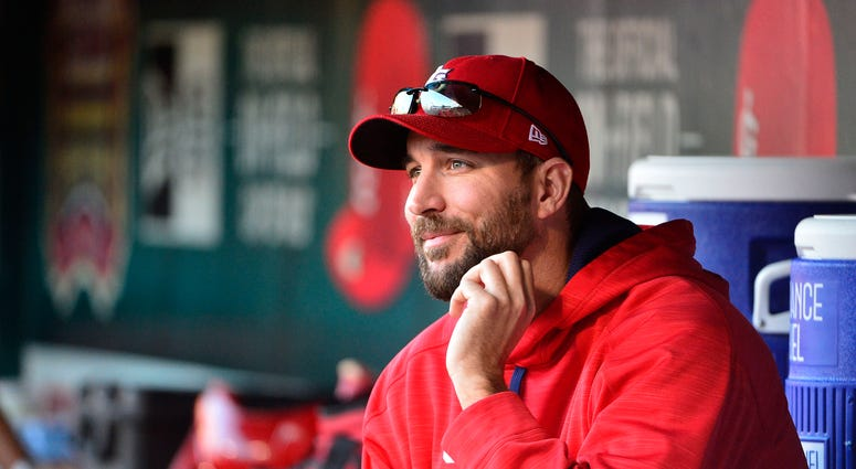 Adam Wainwright sits in the St. Louis Cardinals dugout