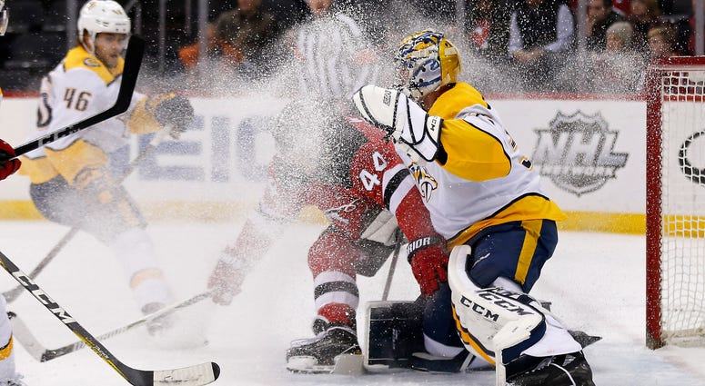 New Jersey Devils left wing Miles Wood (44) is called for interference