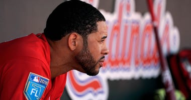 Tommy Pham sits in the St. Louis Cardinals dugout.