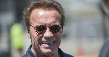 Jun 28, 2015; Sonoma, CA, USA; Actor and politician Arnold Schwarzenegger smiles for fans before the Toyota/SaveMart 350 at Sonoma Raceway.