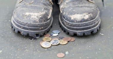 coins at feet
