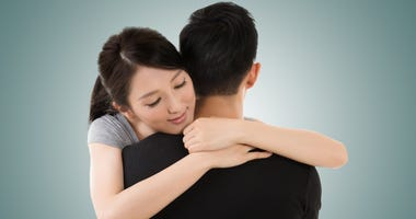 Asian young couple hug and comfort, closeup portrait
