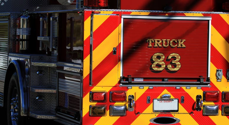 Rear of fire truck in red and yellow.