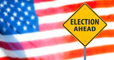 Election ahead sign with the american flag on a background.