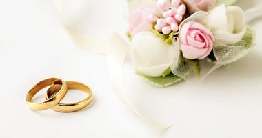 Two golden wedding rings and flowers