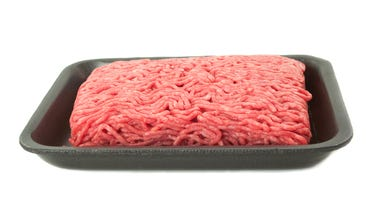 A tray of fresh lean ground beef from supermarket on white background