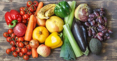 Food photos with fruits and vegetables in a rainbow layout with peppers, tomatoes, apples, carrots, onions, pumpkin, grapefruit, lettuce, celery, turnips, eggplant, grapes, avocados