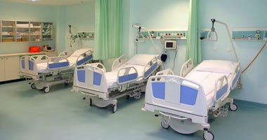 A modern hospital saloon with beds.