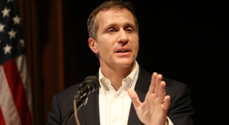 Missouri Governor Eric Greitens tells a reporter that all questions have been answered on his affair as he tries to talk about a new state budget during a press conference at the State Capitol in Jefferson City, Missouri on January 22, 2018. Greitens, who
